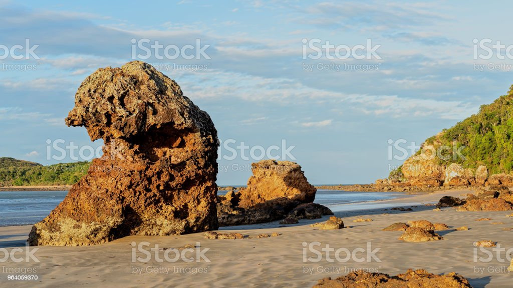 Volcanic Rock Formations Sitting Tall On The Sand Beside The Ocean - Royalty-free Ancient Stock Photo