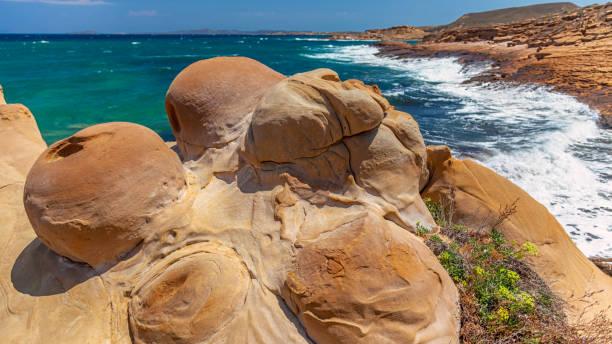 Volcanic Rocks at Faraklo - Lemnos island - Greece stock photo