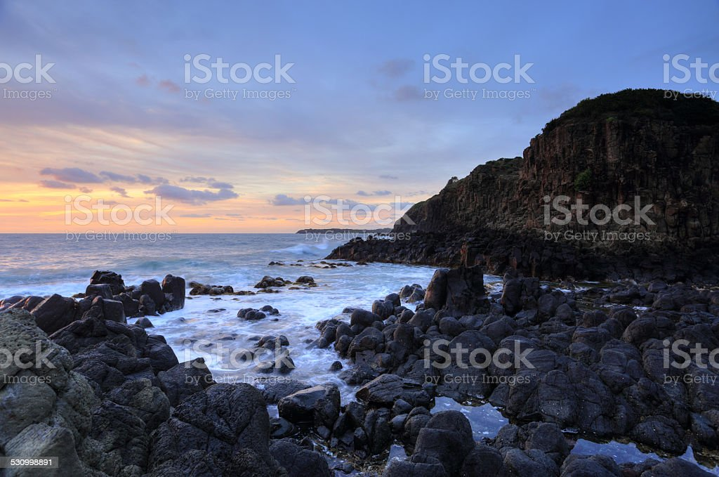 Volcanic rocks of Minamurra at low tide stock photo