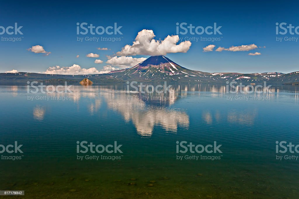 Volcano and lake stock photo