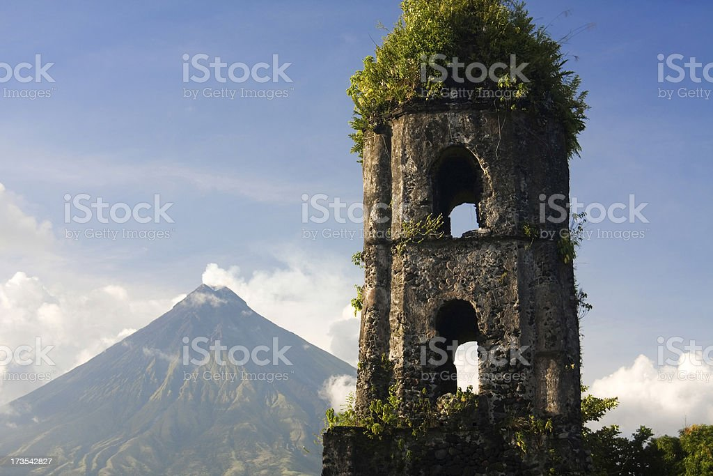 Volcano and ruined tower stock photo