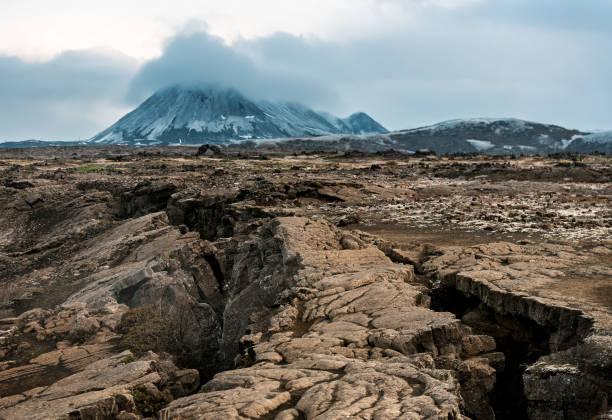 volcano and scary cracked earth stock photo