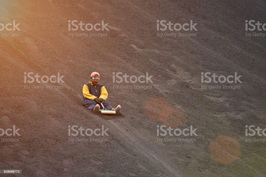 Volcano boarding in NIcaragua stock photo