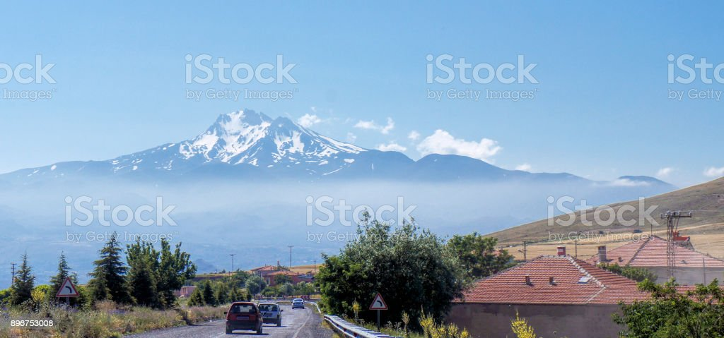 Volcano Erciyes from a distance with a fog bank underneath the summit, Anatolia, Turkey stock photo