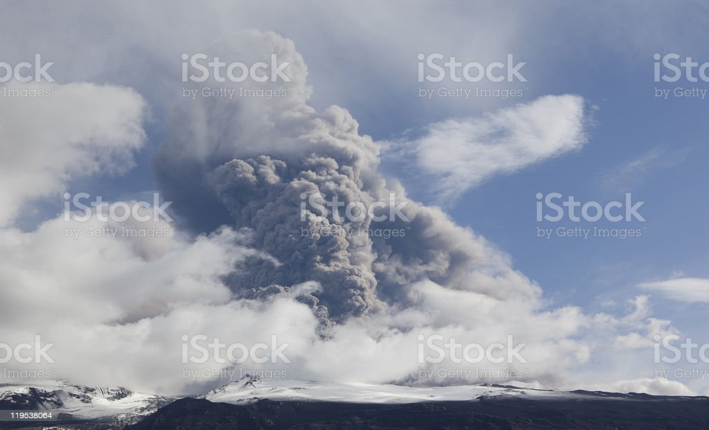 Volcano Eruption in Iceland Ash and blue Sky stock photo