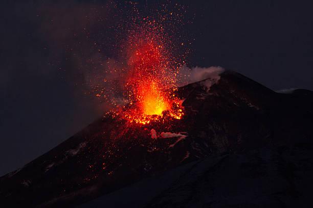 Volcano eruption. Mount Etna erupting from the crater Voragine. stock photo