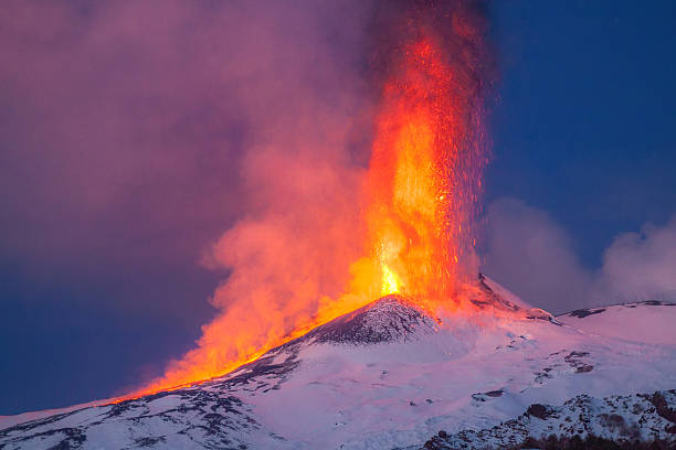 Volcano Etna produces fountain of lava during continued eruption. stock photo