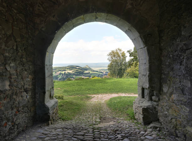 Volcano landscape viewed from the ancient fort gate on the ruins of Hohentwiel, Germany Singen, Germany - August 10. 2011: Volcano landscape viewed from the ancient fort gate on the ruins of Hohentwiel, Germany singen stock pictures, royalty-free photos & images