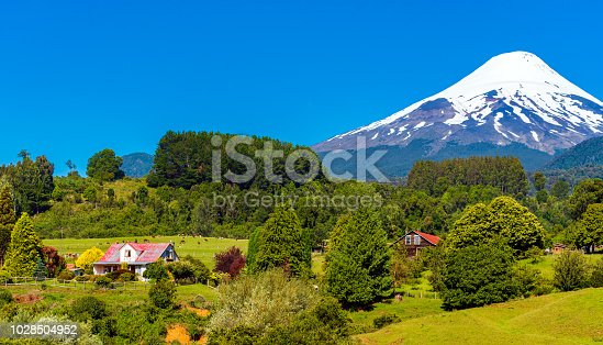 istock Volcano Osorno in national park Vicente Perez Rosales, Chile. Copy space for text. 1028504952