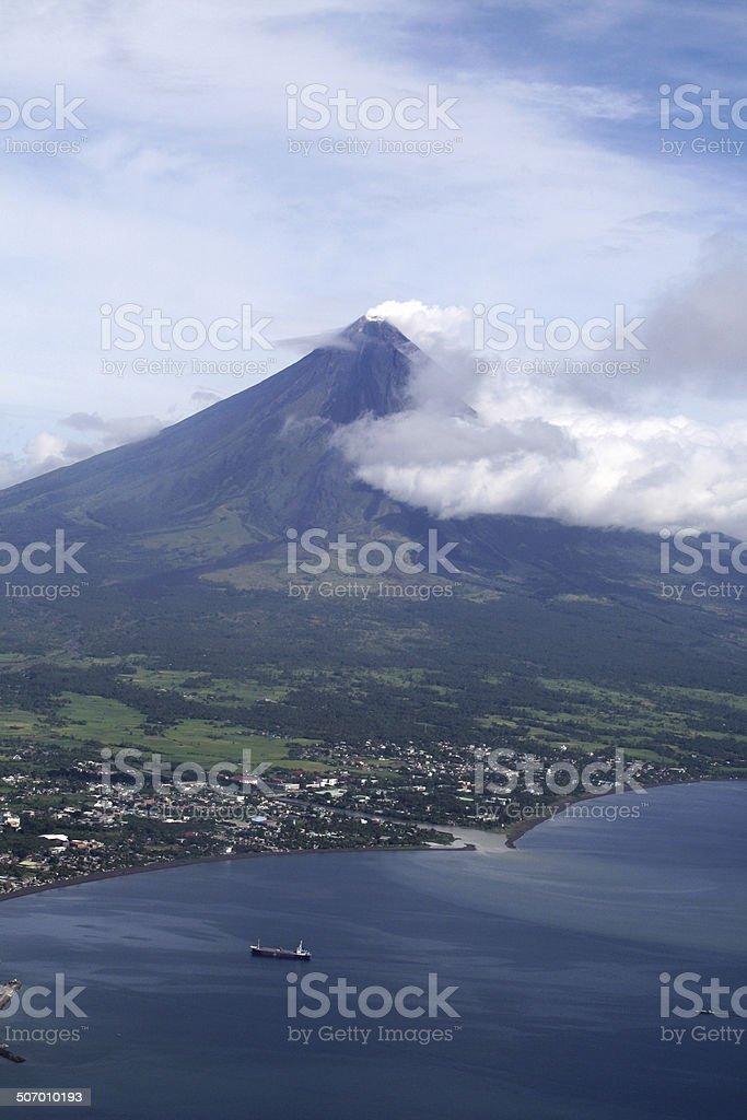 Volcano over a town stock photo