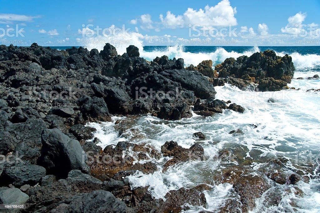 Volcano rocks on beach at Hana Maui Hawaii royalty-free stock photo