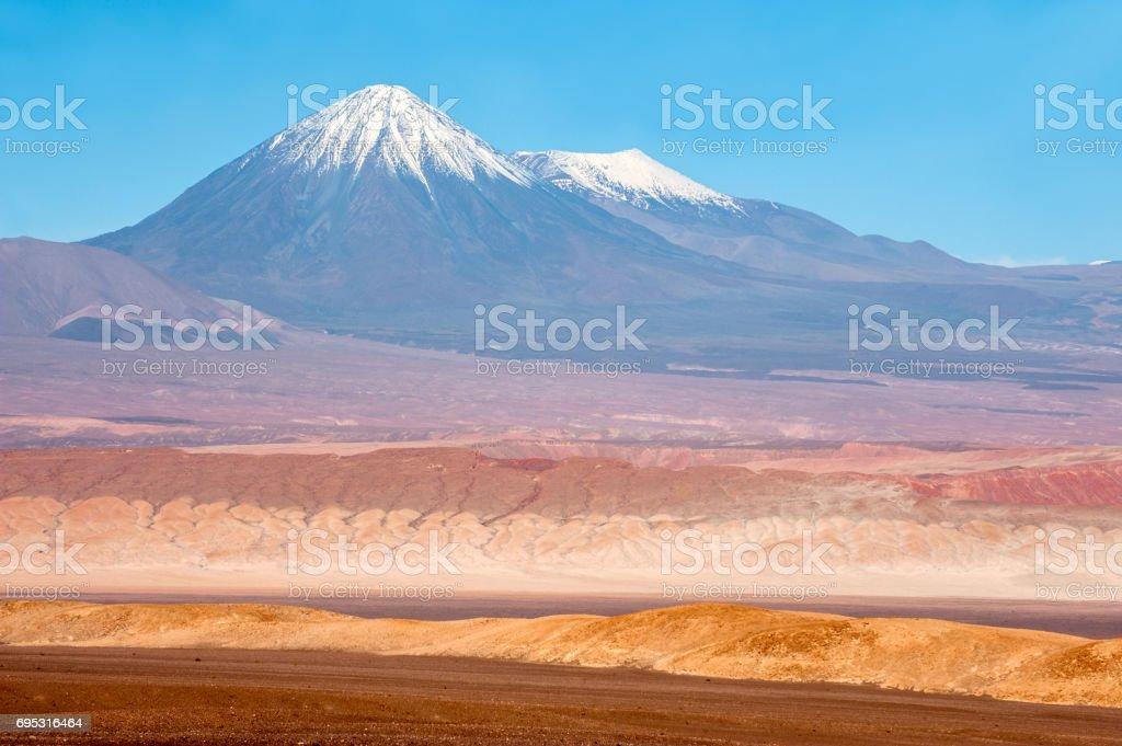 Volcanoes Licancabur and Juriques, Moon Valley, Atacama, Chile stock photo