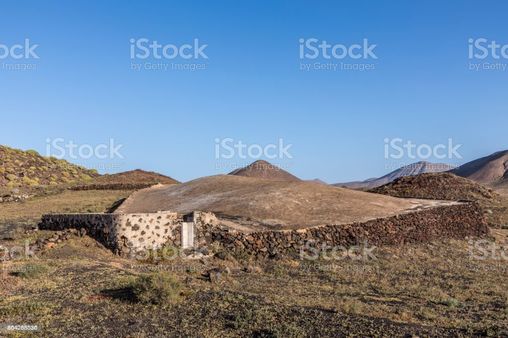 volcanos in Timanfaya national park near Mancha Blanca and old cistern royalty-free stock photo