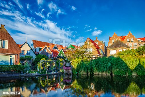 A traditional Dutch village with colorful, old wooden houses, brigdes and canals