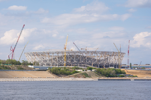 """Volgograd. Russia - May 11 2017. A view of the construction of the football stadium """"Volgograd arena"""" for the World Cup in 2018 with the Volga"""