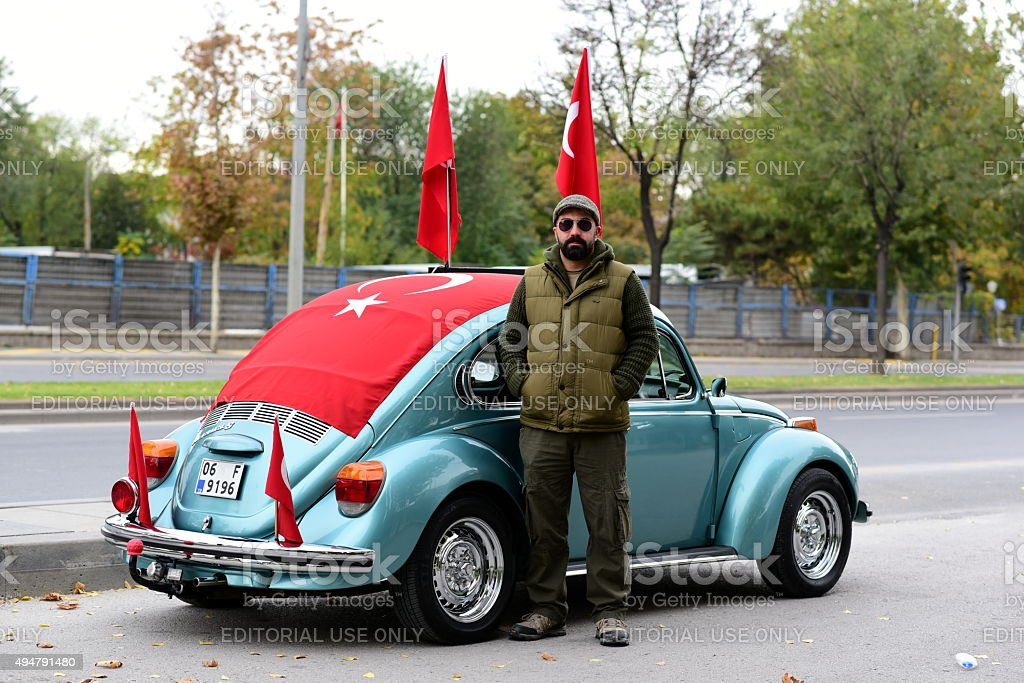 Volkswagen beetle car covered with Turkish flags stock photo