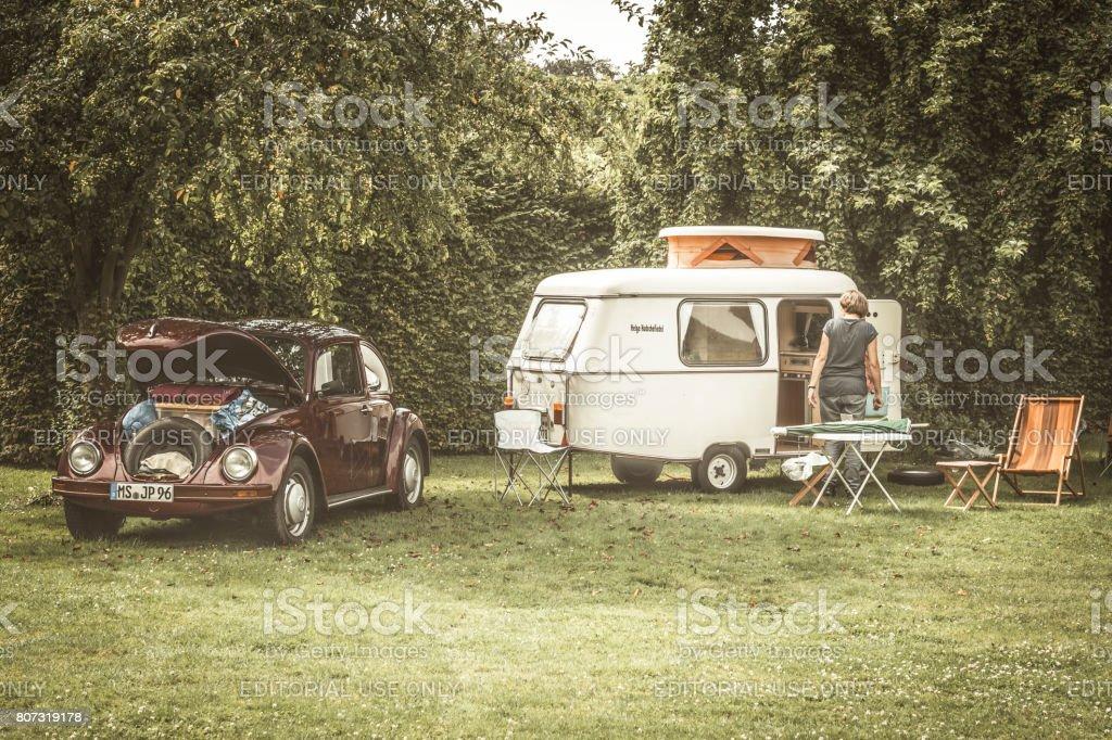 Volkswagen Beetle classic car with a caravan stock photo