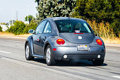 Oct 12, 2019 Redwood City / CA / USA - Volkswagen Beetle driving on the freeway in San Francisco Bay Area