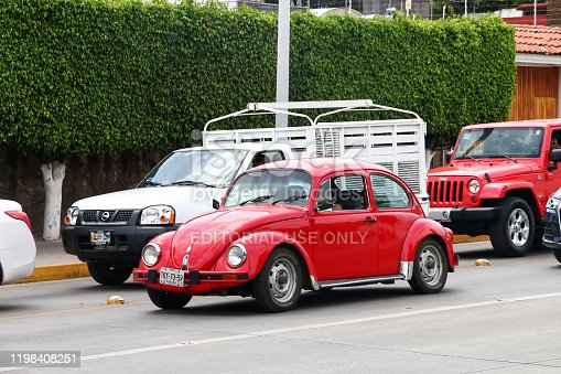 Oaxaca, Mexico - May 25, 2017: Red motor car Volkswagen Beetle in the city street.
