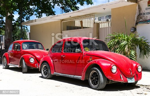 Tulum, Mexico - May 17, 2017: Motor cars Volkswagen Beetle in the city street.