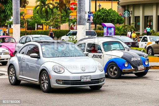ACAPULCO, MEXICO - MAY 30, 2017: Motor cars Volkswagen Beetle in the city street.