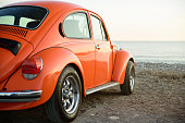 Izmir, Turkey - October 21, 2017 :Classic orange wolkswagen beetle, photo taken in a sea coast of Izmir city, Turkey. No people around.