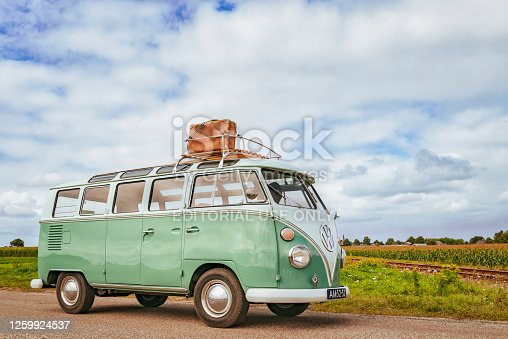 istock Volkswagen Bus Type 2 T1 camper van driving through the countryside 1259924537
