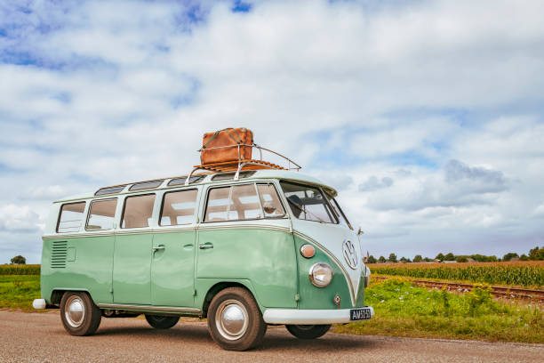 Volkswagen Bus Type 2 T1 camper van driving through the countryside stock photo