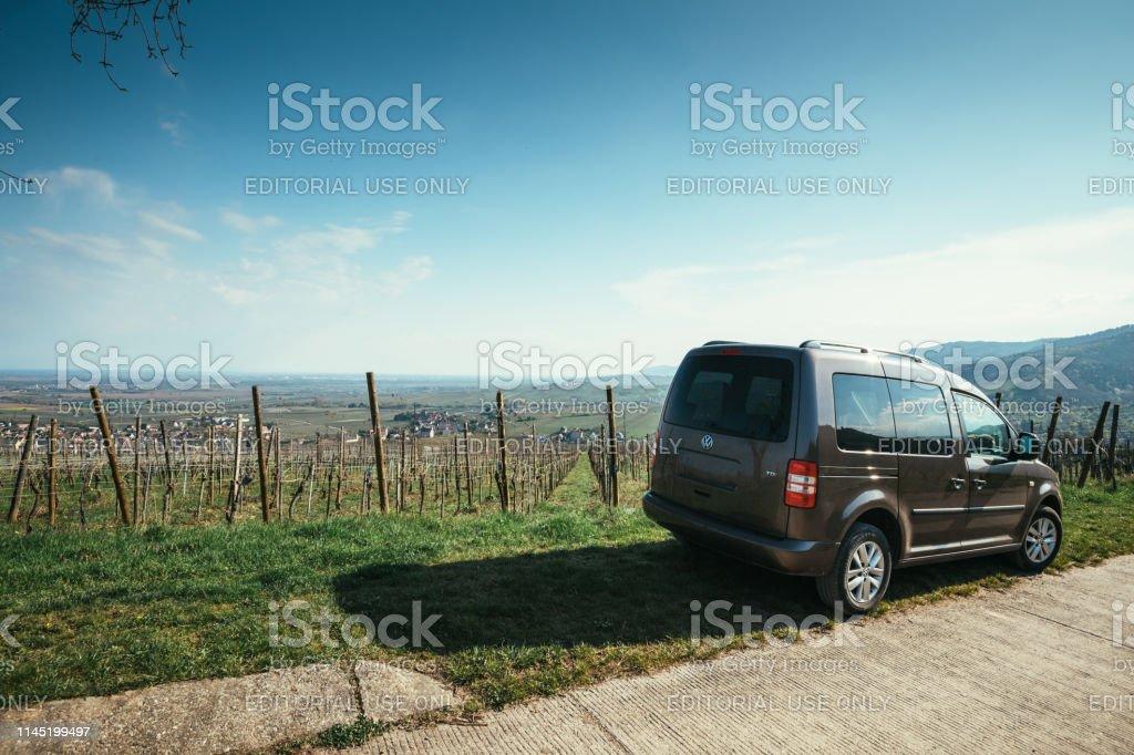 Vw Volkswagen Caddy Van Parked In Vineyards Of Alsace Stock Photo