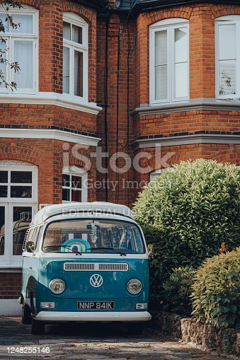 London, UK - May 26, 2020: Volkswagen camper van with rainbow in the window parked in front of a house in Palmers Green, a suburban area in the London Borough of Enfield in North London, England.
