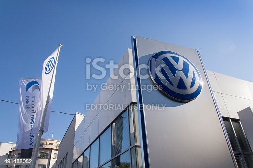 istock Volkswagen car maker logo on a building of czech dealership 491488082