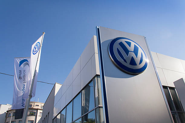 Volkswagen car maker logo on a building of czech dealership Prague, Czech republic - October 1, 2015: Volkswagen car maker logo on a building of dealership on October 1, 2015 in Prague, Czech republic. vehicle brand name stock pictures, royalty-free photos & images