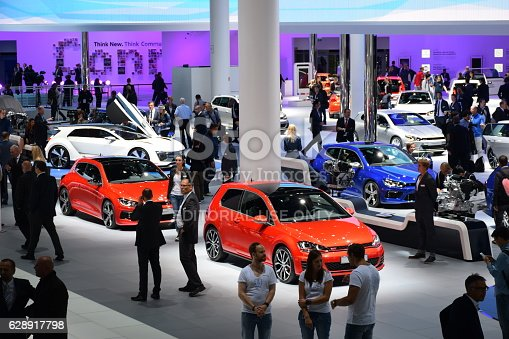 Frankfurt, Germany - September, 15th, 2015: The visitors (especially journalists and businessmens) are looking on the new Volkswagen cars on the motor show. The Volkswagen Group delivered over 10 million cars to customers in 2014. This result was achieved four years earlier than expected.