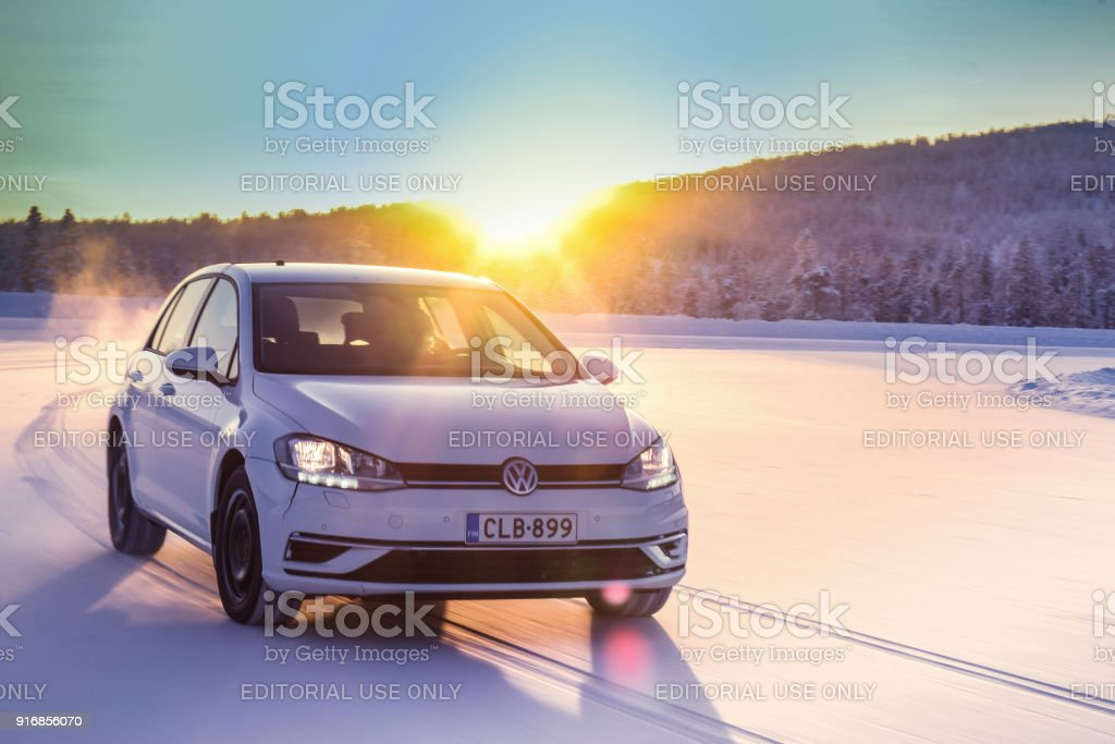 Volkswagen Golf drives on snow in Lapland stock photo