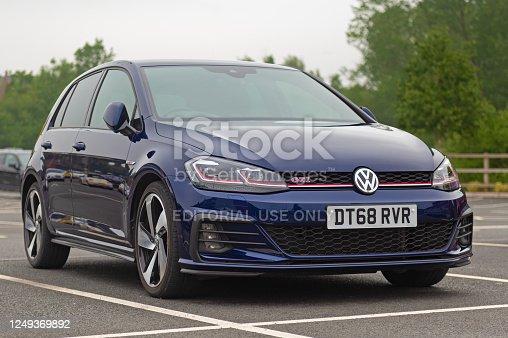 Staffordshire, England, UK - 13 June 2020: A Volkswagen Golf GTI Mk 7 facelift version in Atlantic Blue paint.