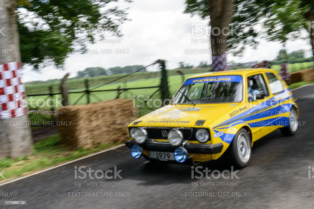 Volkswagen Golf I 'Pierburg' classic rally car driving on a country road. stock photo