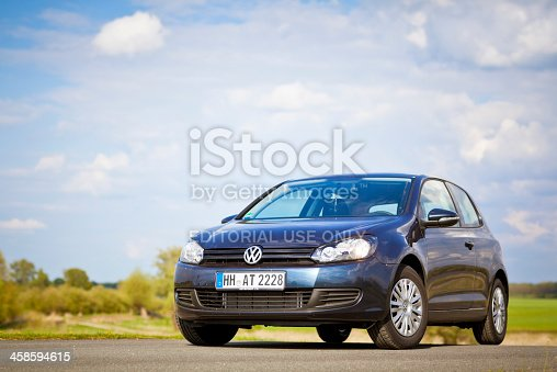 Dannenberg, Germany - May 1, 2010: Dark Blue Volkswagen Golf (Golf Mk6-series) on a dike along the Elbe near Dannenberg on the Elbe (Germany). The Volkswagen Golf Mk6 (or VW Typ 5K) is the successor to the Mk5, and was unveiled at the Paris Auto Show in October 2008. The Volkswagen Golf is a small family car manufactured by Volkswagen since 1974 and marketed worldwide across six generations, in various body configurations and under various nameplates – as the Volkswagen Rabbit in the United States and Canada (Mk1 and Mk5), and as the Volkswagen Caribe in Mexico (Mk1).