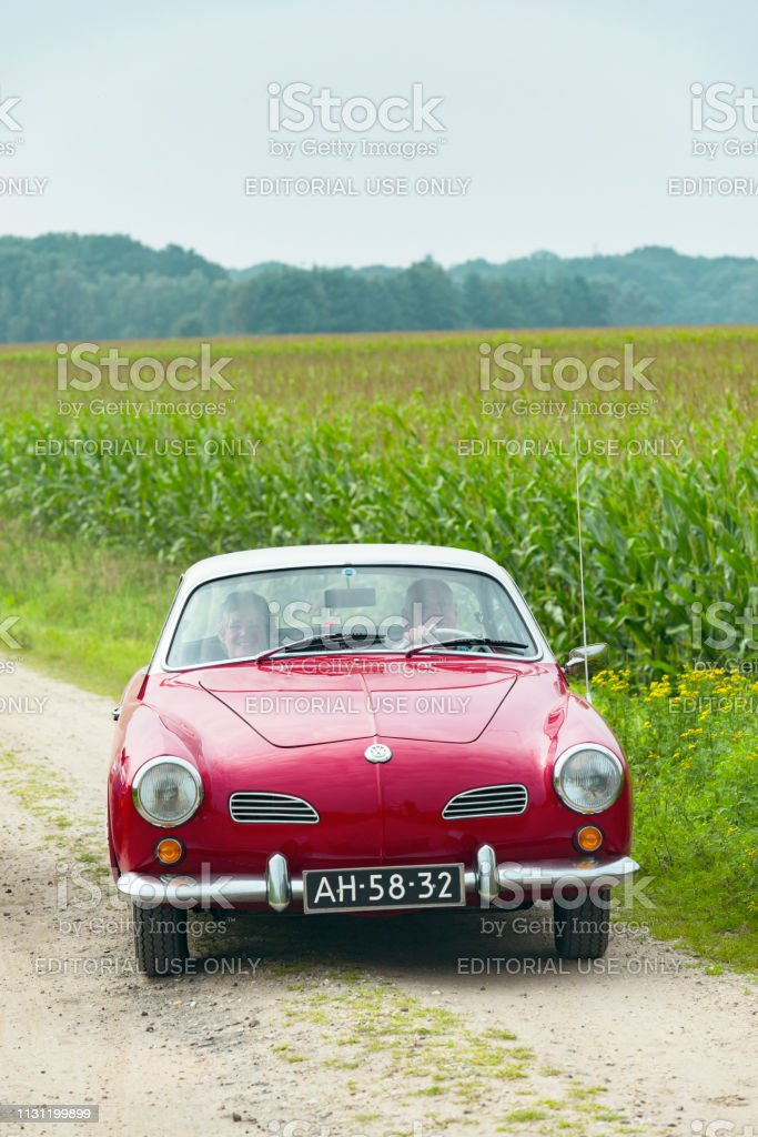 Volkswagen Karmann Ghiad riving on a country road stock photo