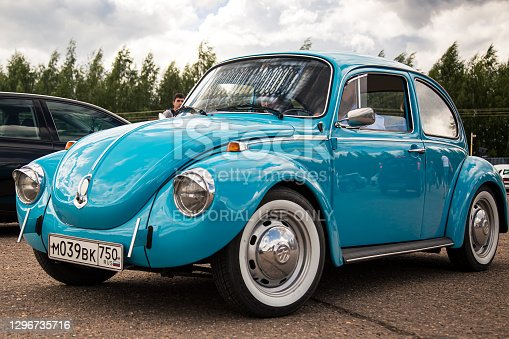 istock Moscow, Russia - July 06, 2019: Volkswagen Käfer 1303. Type 1 Vintage VW Beetle was produced since 1946. A blue retro car stands in the parking lot with a driver inside. Front side view 1296735716