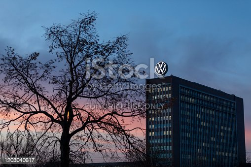 Wolfsburg, Germany - jan 30th 2020: Volkswagen old headquarters is a visible landmark in city of Wolfsburg. Massive VW -logo on top of the building is illuminated and visible at all times.