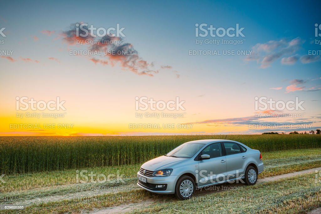 Volkswagen Polo Car Parking  Wheat Field. Sunset Sunrise Dramatic Sky stock photo