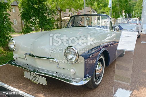 Jüchen, Germany - August 1, 2014: Volkswagen Rometsch Lawrence cabriolet 1959 front view. The car is on display during the 2014 Classic Days event at Schloss Dyck. People in the background are looking at the cars.