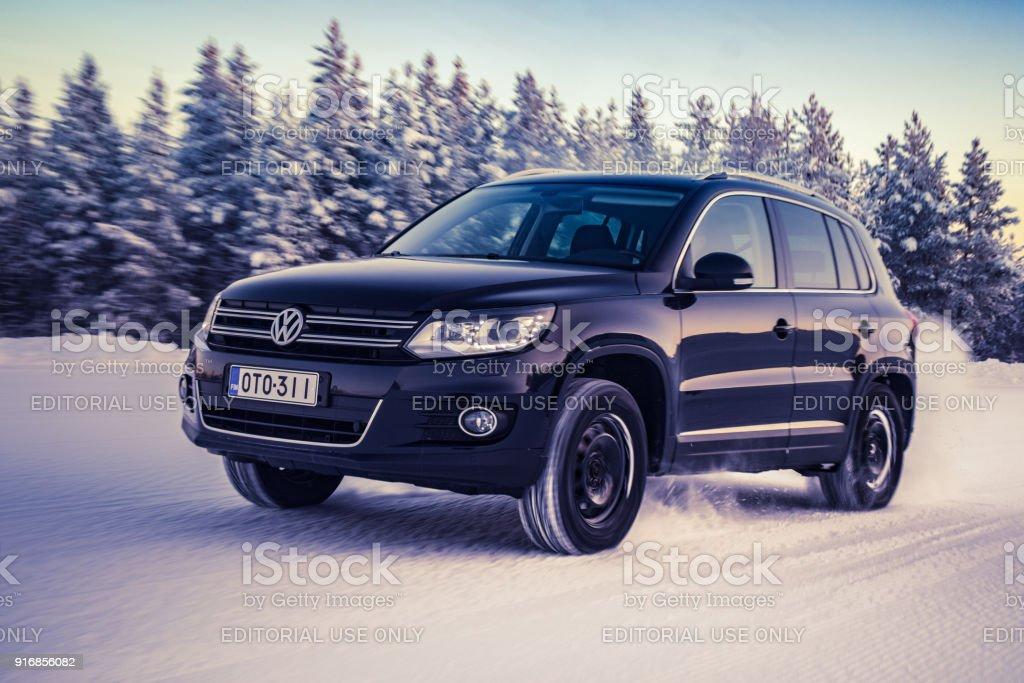 Volkswagen Tiguan accelerates on snow stock photo