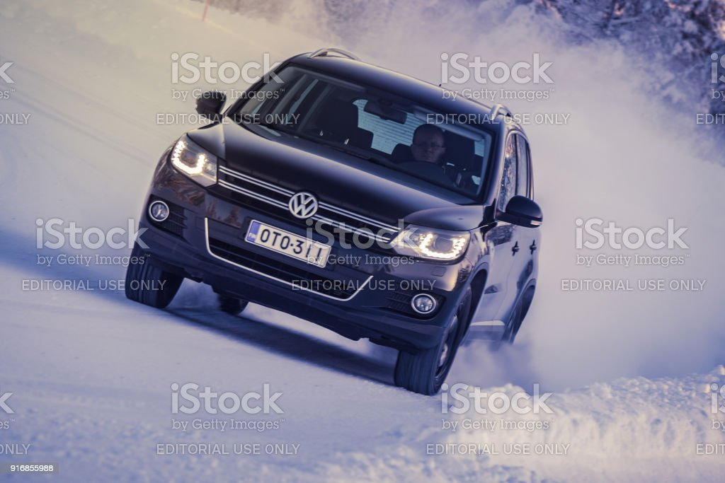Volkswagen Tiguan drives on Lapland forest road stock photo