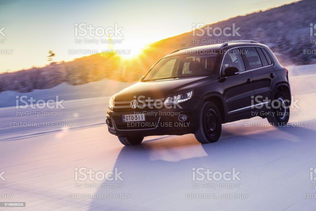 Volkswagen Tiguan drives on snow in Lapland stock photo