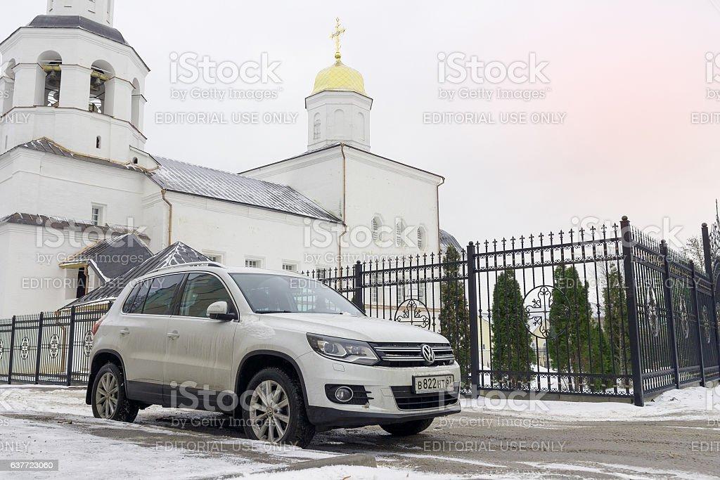 Volkswagen Tiguan near a church. stock photo