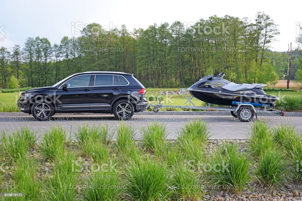Volkswagen Tiguan with trailer and jet ski stock photo