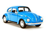 Izmir, Turkey, March 03, 2015: Vintage toy car in front of a white background. The Volkswagen Type 1, widely known as the Volkswagen Beetle, was an economy car produced by the German auto maker Volkswagen (VW) from 1938 until 2003