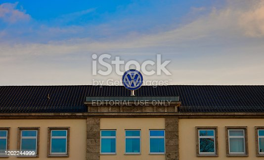 Braunschweig, Germany, January 11., 2020: Cloesup of Volkswagen trademark on the roof of the administration building in Braunschweig