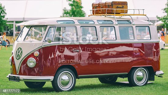 Jüchen, Germany - August 1, 2014: 1950s Volkswagen Transporter T1 mini van split screen on display during the 2014 Classic Days event at Schloss Dyck. People in the background are looking at the cars.